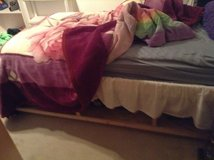 Twin bed frame(no mattress)with 6 built in storage shelves. in Ramstein, Germany